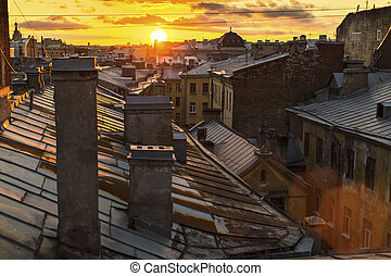 Amazing sunset on the roofs
