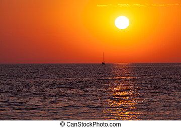 Amazing sunset over blue sea