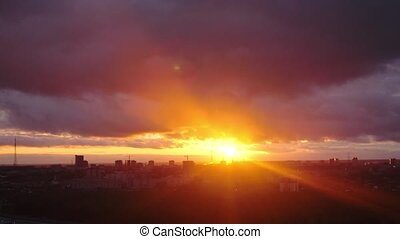 Amazing sunset over city, close up on modern downtown Novosibirsk skyline buildings. Time lapse