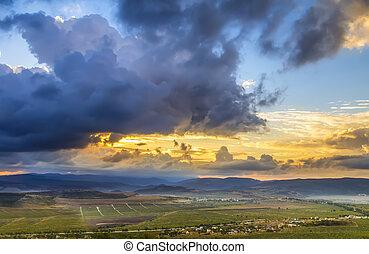 amazing sunset over the mountains on horizon