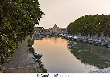Amazing Sunset view of Tiber River and St. Peter's Basilica in Rome