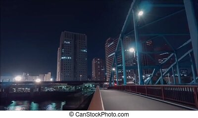 Amazing time lapse panorama aerial on busy traffic urban highway road in bright night light modern downtown architecture
