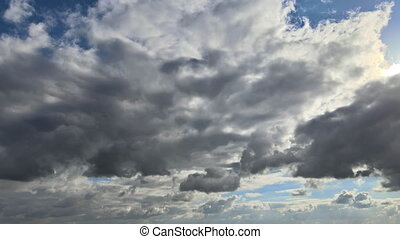 Amazing timelapse of soft flying through beautiful thick fluffy white clouds moving slowly on the clear blue sky in pure daylight.