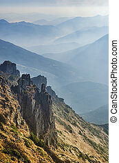 Amazing view from Chornogora ridge, Ukraine. Sharp rocks of Spytsi mountain and blue mountain valleys.