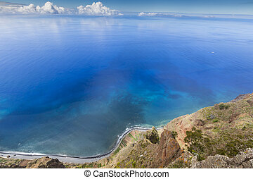 Amazing view from the highest Cabo Girao cliff on the beach, ocean water and Camara de Lobos town, Madeira island, Portugal