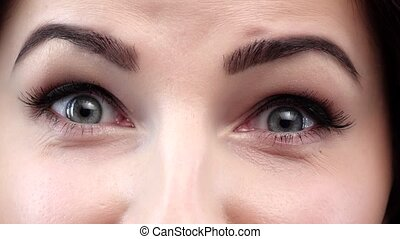 Amazing view of a girl wiht blue eyes. Closeup - Amazing...