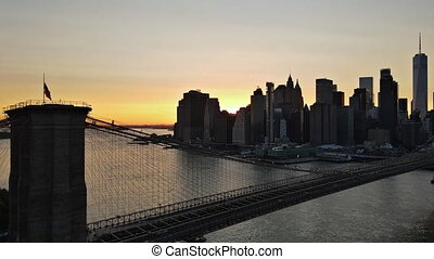 Amazing view on Brooklyn Bridge evening Manhattan over East River at sunset, New York USA