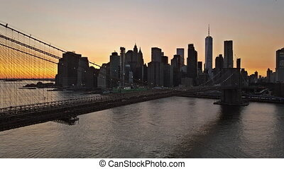 Amazing view on Brooklyn Bridge and Manhattan nyc skyline, evening over East River at sunset, New York USA