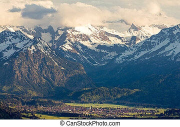 Amazing view Snow-covered Mountains with village in valley. Sunset or Sunrise in Oberstdorf, Germany.