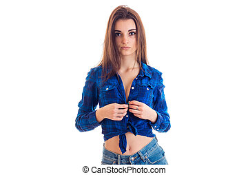 amazing young girl with long hair stands in front of the camera in unbuttoned shirt close-up