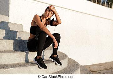 Amazing young sports woman listening music
