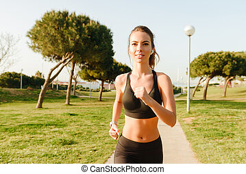 Amazing young sports woman running