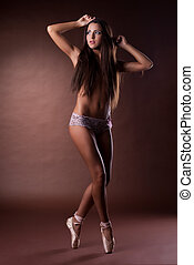 Amazing young woman posing on sexy pointes
