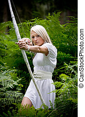 a young amazon with a bow in the rainforest