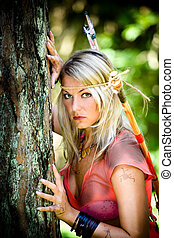 amazon girl - a young amazon with a bow in the rainforest