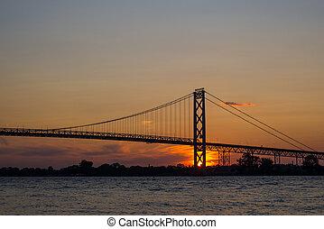 Ambassador Bridge connecting Windsor, Ontario to Detroit Michigan at dusk
