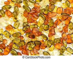 Amber beads on white background