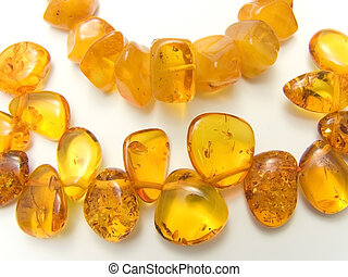 amber good-looking beautiful beads overflowing gold of...