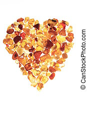 Amber heart - Heart on white background, layed with amber ...