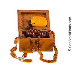 Amber jewelry in retro wooden box isolate on white