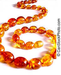 Amber necklace - Closeup of an amber necklace on white ...