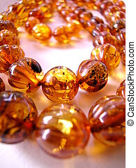 Amber necklace - Closeup of an amber necklace on white...