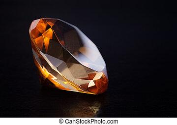 Amber stone. - Close-amber stones on black background.