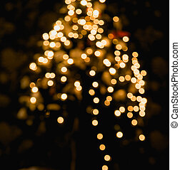 Ambient scene with Christmas tree on dark background