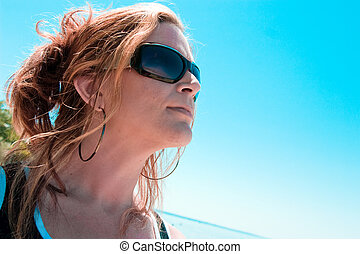 Ambition and Blue Skies - A woman looks at the clear blue...