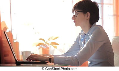 ambition businesswoman typing on her laptop