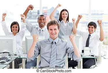 Ambitious business team celebrating success