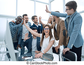 Ambitious business team celebrating success in the office