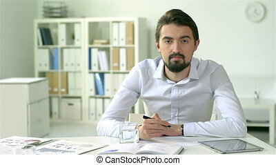 Ambitious - Businessman with an ambitious look working in...