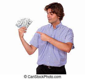 Ambitious young man pointing cash dollars
