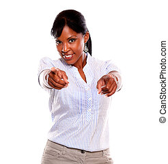 Ambitious young woman pointing and looking at you