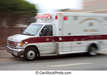 An ambulance blazes by, it's sirens whaling. An intentional camera blur gives a feeling of a rushed tension to the scene.