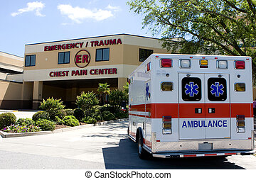 An ambulance pulls into a modern hospital emergency room entrance.
