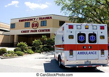 Ambulance At ER - An ambulance pulls into a modern hospital...