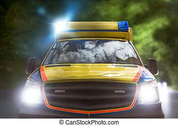 ambulance car speeding on a country road