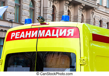 Ambulance car with Blue Flashing Light on the roof. Text in...