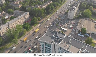 Ambulance in city traffic aerial cars jams drone view truck right panorama camera movement sunset