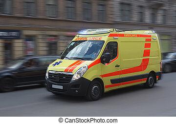 Ambulance moves on a city street.