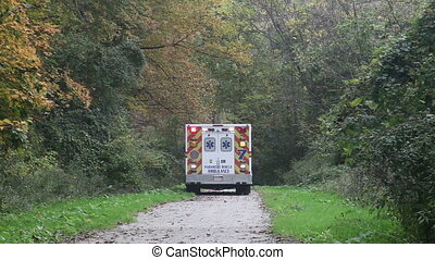 Ambulance on rescue mission in a remote narrow trail in the...