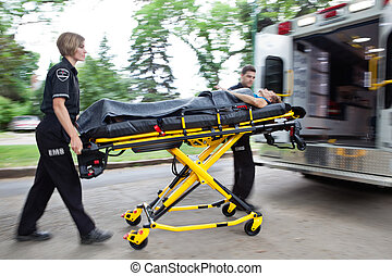 Ambulance Rush - Man and woman ambulance team rushing a ...
