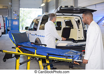 ambulance team preparing the vehicle