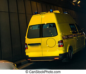 Ambulance van drives in tunnel