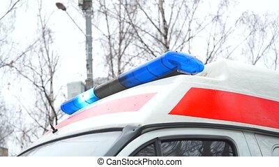 Ambulance vehicle blue flashing lighting in action