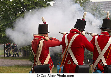 Soldiers firing on the enemy, reenactment of War of 1812