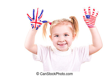 American and English flags on child's hands. Learning...