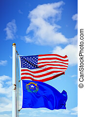 An American and Nevadan flag on a white flagpole
